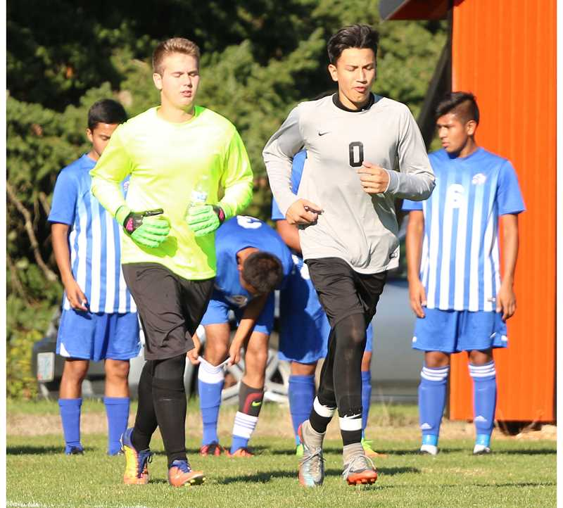 MARY BRAVO/FOR THE PIONEER - Jared Holliday (left) and Byron Patt (right) split goalkeeping duties for Madras during the season, and both were named honorable mentions.