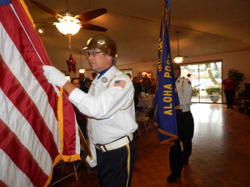 BARBARA SHERMAN - The Aloha American Legion Post 104 Color Guard posts the colors in the Royal Villas Clubhouse at the beginning of the Veterans Day breakfast.