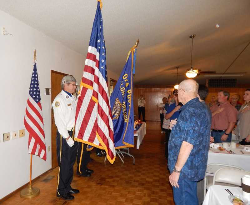 BARBARA SHERMAN - Royal Villas residents and guests recite the pledge of allegiance after the Aloha American Legion Post 104 Color Guard prepares to post the colors.