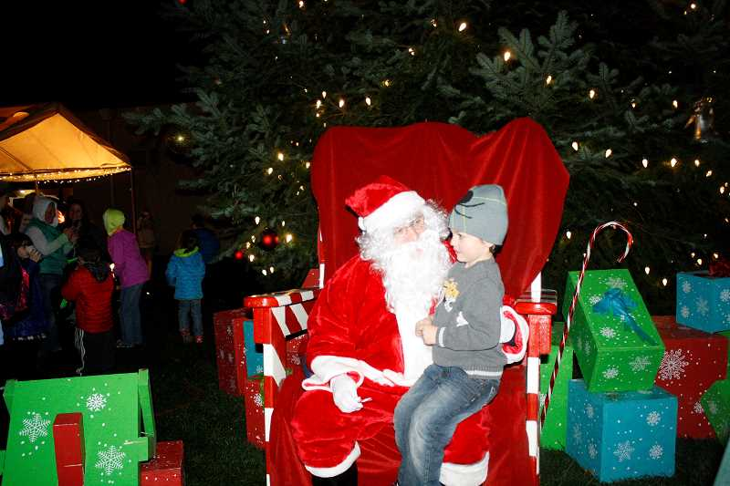 FILE PHOTO - The city's annual tree lighting celebration will take place from 5-7 p.m. Friday, Dec. 1, at Harvest Market Square in downtown Estacada.