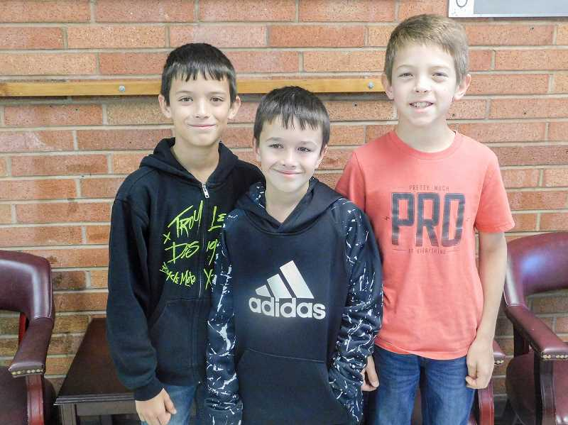 ESTACADA NEWS PHOTO: EMILY LINDSTRAND - Triplets Loggan, Tayson and Benson Trujillo are in fifth grade at River Mill Elementary School.