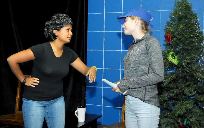 SETH GORDON - C.S. Lewis Academy senior Meghan Cammack and freshman Hannah Galambos rehearse a scene for the school's upcoming production of 'A Tuna Christmas' Friday, Saturday and Sunday at the Chehalem Cultural Center's Black Box Theater. The comedy is a send-up of small-town life in fictional Tuna, Texas.