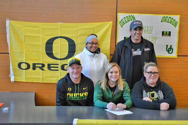 SPOTLIGHT PHOTO: JAKE MCNEAL - Indians senior shortstop Hannah Galey, center, pictured with, from left, her father Wayne, Scappoose softball coach Cijay Koler, Diamond Pro NW hitting coach Dennis Muir and mother Tina Galey, announced her decision to attend and play softball for the University of Oregon Wednesday at Scappoose High School.