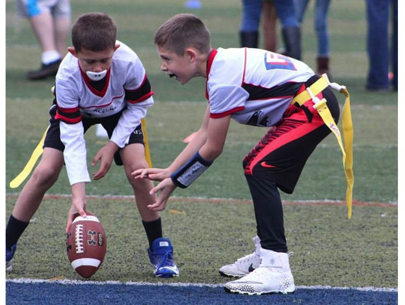 CONTRIBUTED PHOTO - William Keeney prepares to take the snap during a flag football game in the Canby Youth Football League.