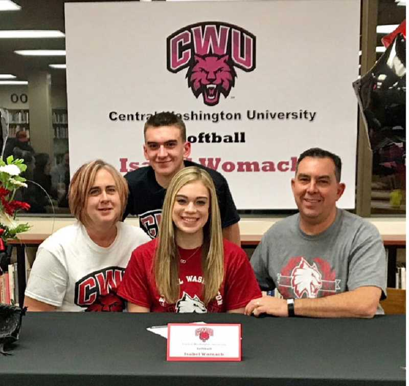 COURTESY PHOTO - Glencoe standout pitcher Isabel Womack signs her letter of intent with family Nov. 14 at Glencoe High School.