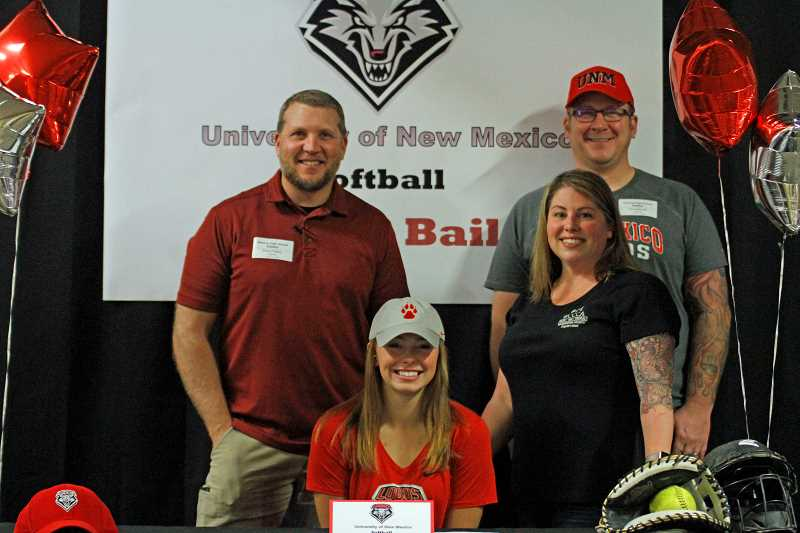 HILLSBORO TRIBUNE PHOTO: WADE EVANSON - Glencoe three-sport athlete Ash Bailey signs her letter of intent with her friends and family iat Glencoe High School Tuesday, Nov. 14.