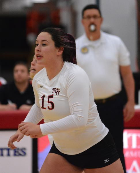 OUTLOOK PHOTO: DAVID BALL - Madison Pernich led the Saints with 13 kills during their five-set loss to Pierce College in the first round of the Northwest volleyball playoffs Thursday.