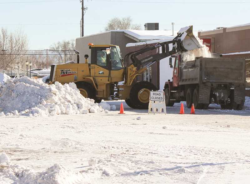 CENTRAL OREGONIAN - Snow is removed from a street in downtown Prineville last winter.