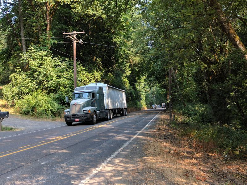 SPOTLIGHT FILE PHOTO - A tractor trailer truck makes its way toward Washington County using Cornelius Pass Road. The road is slated to be transfered to state jurisdiction, but it's unclear when that will take place.