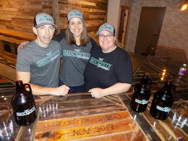 TIMES PHOTO: RAY PITZ - Keith Laber, left, and Erin Koenig will run the brewing side of Smockhouse Brewhouse while Shannon Johnson will run the restaurant part in the new business located in the Sherwood Center for the Arts.