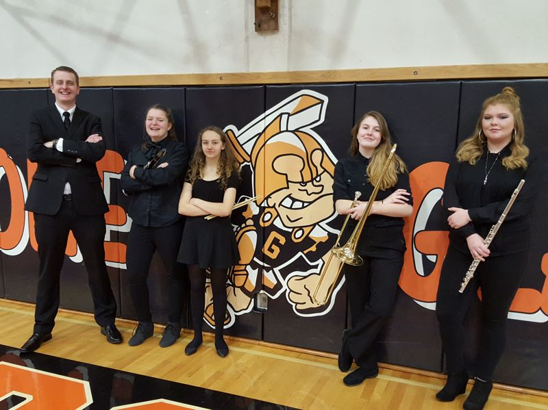 SUBMITTED PHOTO: LESLIE ROBINETTE - Gladstone High School band director Seth Arnold poses with some of the students chosen for the All-State Honor Band. Pictured are Jordyn Layton, Sequoia Bumpus, Sadie Klaus, and Susie Beck.