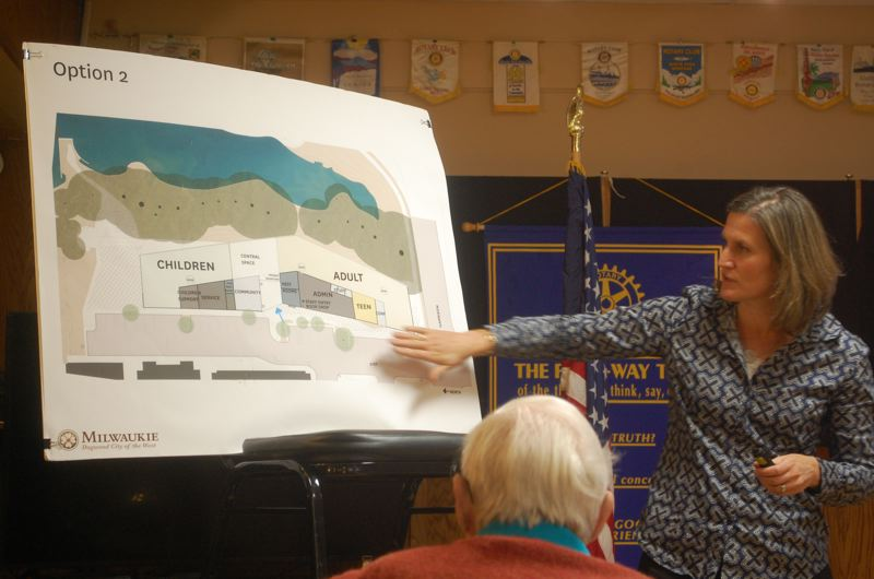 PHOTO BY: RAYMOND RENDLEMAN - Laura Klinger, the Ledding Library project's architect from Hacker, shows the latest floor plans to attendees of the Nov. 14 meeting of the Milwaukie Rotary Club.