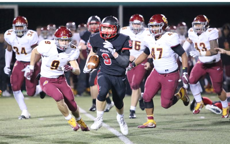 REVIEW/NEWS PHOTO: JIM BESEDA - Clackamas' James Millspaugh breaks loose on a 31-yard touchdown run with 9:51 to play in the fourth quarter against Central Catholic Friday at Cavlaiers Stadium.