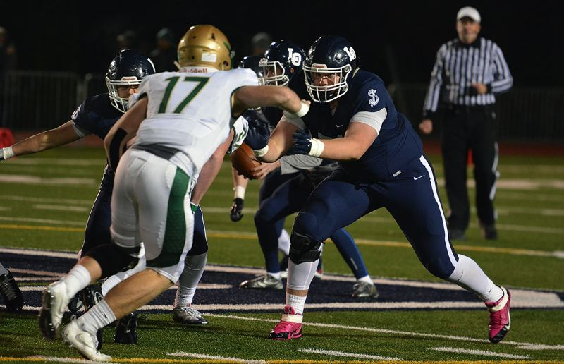 TIMES PHOTO: MATT SINGLEDECKER - Lake Oswego senior left tackle Dawson Jaramillo and the Lakers rolled past Jesuit in the 6A quarterfinals.