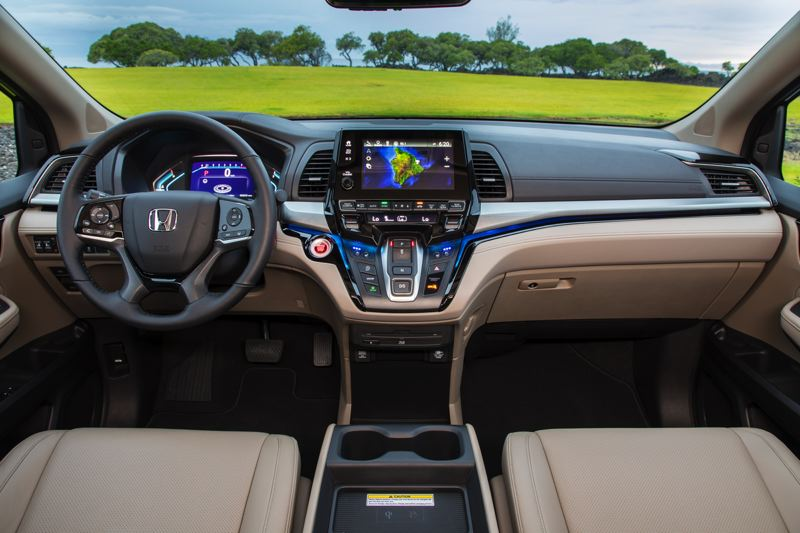 HONDA NORTH AMERICA - The new dash design in the 2018 Honda Odyssey ieatures a large display screen that seems to float above the controls, including a space-saving push button transmission shifter.