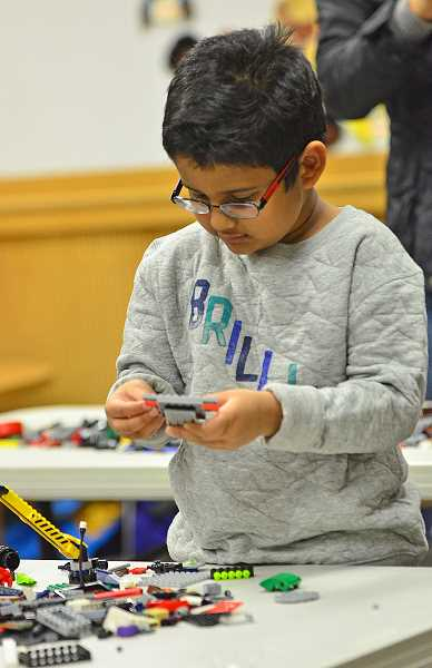 SPOKESMAN PHOTO: VERN UYETAKE - Sid Veeravajhula, 5, of Wilsonville, works on his Lego creation.