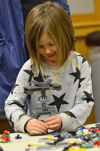 SPOKESMAN PHOTO: VERN UYETAKE - Grace Demaray, 4, works on her masterpiece.