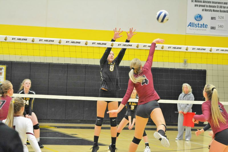 SPOTLIGHT PHOTO: JAKE MCNEAL - Outside hitter Savannah Moore (8) is a second-teamer.
