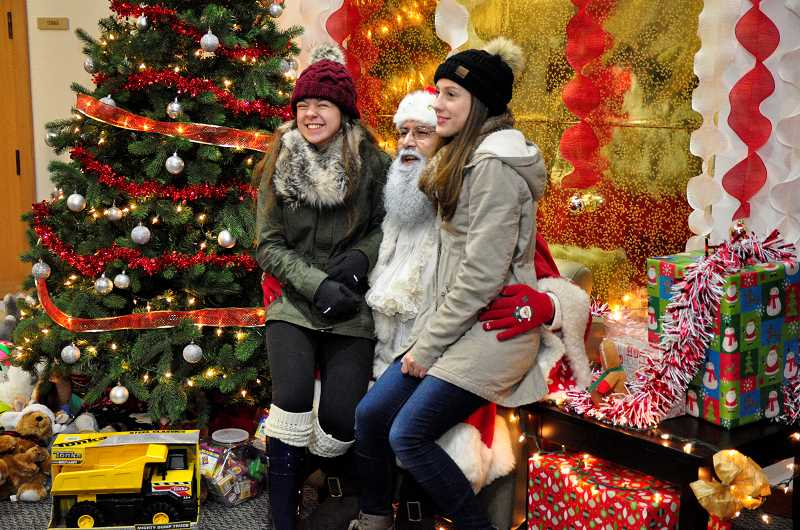 SPOKESMAN FILE PHOTO - Visits with Santa are only one fun aspect the Holiday Tree Lighting.