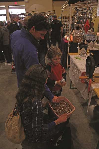 INDEPENDENT FILE PHOTO - Families can peruse the various stands of vendors at the Hazelnut Festival's German holiday market during the event Dec. 2-3 at the Mount Angel Festhalle.