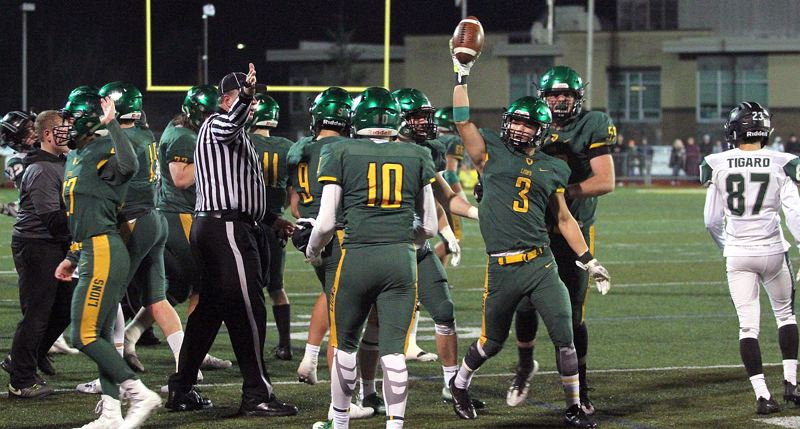 TIDINGS PHOTO: MILES VANCE - West Linn senior Cody Fretwell holds the ball aloft after recovering an onside kick with 52 seconds left in his team's 24-21 loss to Tigard in the Class 6A state quarterfinals at West Linn High School on Friday.