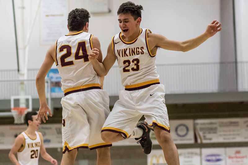 NEWS-TIMES FILE PHOTO - Forest Grove's Drake and Guy Littlefield celebrate during a Vikings game at Forest Grove High School last season.
