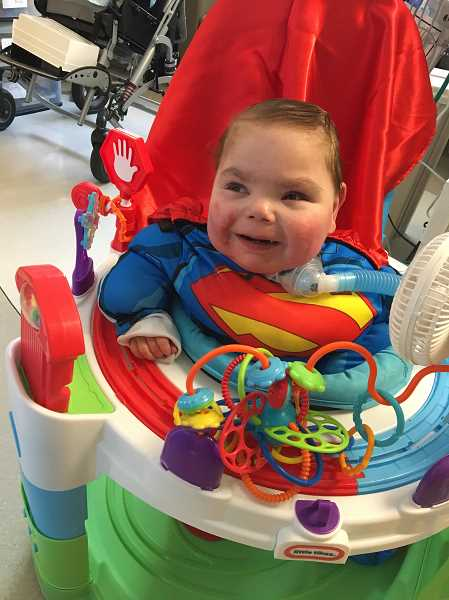 COURTESY OF TARA OUELLETTE-STONE - Although Ashton Stone is back home, he will still have to stay for a while at Randall Childrens Hospital at Legacy Emanuel for a time, a place where he spent much of his early life