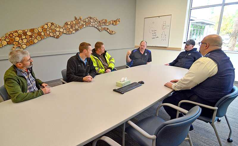 REVIEW PHOTO: VERN UYETAKE - Public Works Director Anthony Hooper (right) and members of the Oregon Association of Water Utilities hold a meeting in one of the Operations and Maintenance Center's two new conference rooms, which will be available to the public.