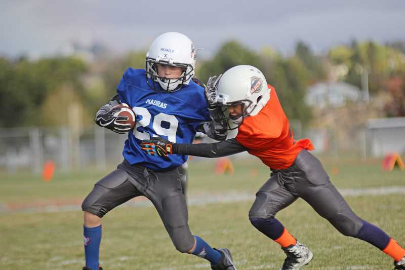"""JOE MCHANEY/FOR THE PIONEER - This fall, teams from Culver, Madras and Warm Springs were part of a brand new youth tackle football league for fifth- and sixth-graders. League organizers opted to eliminate special teams plays and have 8-man teams rather than 11. The league also adheres to USA Football's """"Rookie Tackle"""" pilot program, meant to bridge the gap between flag and 11-man tackle rules."""