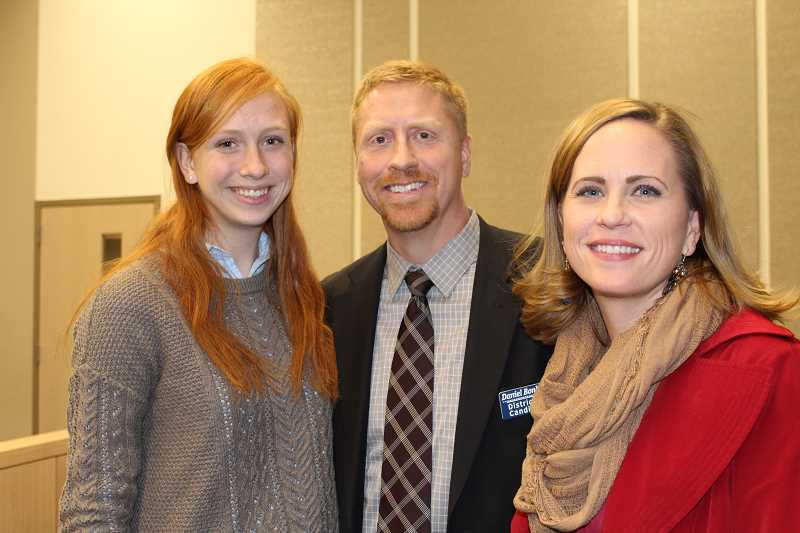 HOLLY M. GILL - Daniel Bonham is flanked by his daughter, Jennifer, and wife, Lori, at right.