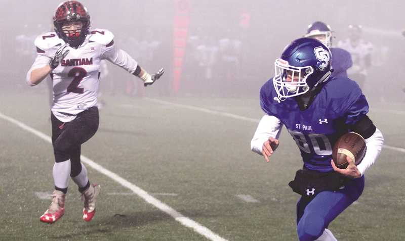 PHIL HAWKINS - WOODBURN INDEPENDENT - St. Paul wide receiver Jaidyn Jackson races up field during the Bucks' 23-22 loss to Santiam in the 2A state semifinals.