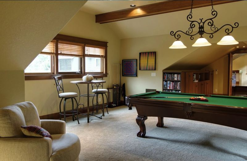 SUBMITTED: LAURA SABO - Local interior designer Laura Sabos work on a bonus room with a pool table.