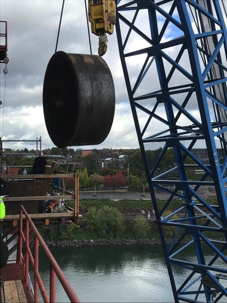SUBMITTED: MULTNOMAH COUNTY - Removing the old Rall wheels with the 4100W Manitowoc Crane. No one else in the world has had to replace wheels of this size — this type of bridge was often completely replaced before they wore out.