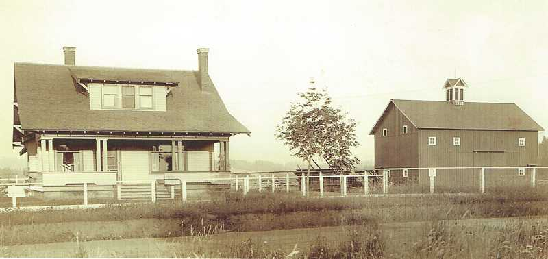 COURTESY OF MOLALLA AREA HISTORICAL SOCIETY - The 80 acres of Ashdale Farm was William Walter and Annie Everhart's home in 1913 and for many years after. In this 1913 photo, it looks lonely on the Molalla Prairie. Today, the barn is gone and the house is surrounded by neat residential homes.