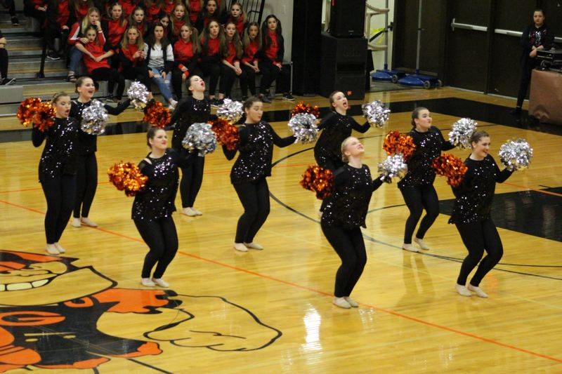 PHOTO COURTESY OF CHERIESSE COMER - The Scappoose Vision Dance Team performs their pom routine during the Happy Feet competition at Scappoose High School on Saturday, Nov. 18. The team is now preparing for category championships in early December, marking the end of the fall competition season.