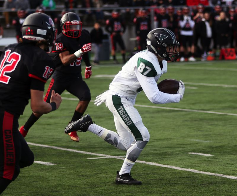 DAN BROOD - Tigard sophomore Hunter Gilbert breaks into the clear on his way to returning a Clackamas kickoff 33 yards in Friday's game.