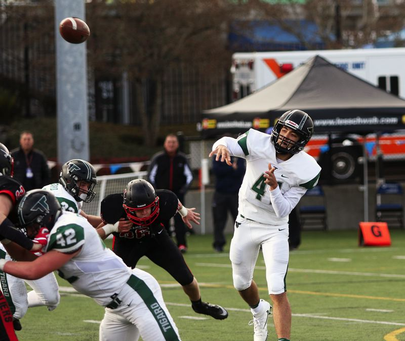 DAN BROOD - Tigard freshman quarterback Drew Carter throws a pass during Friday's state playoff semifinal game.
