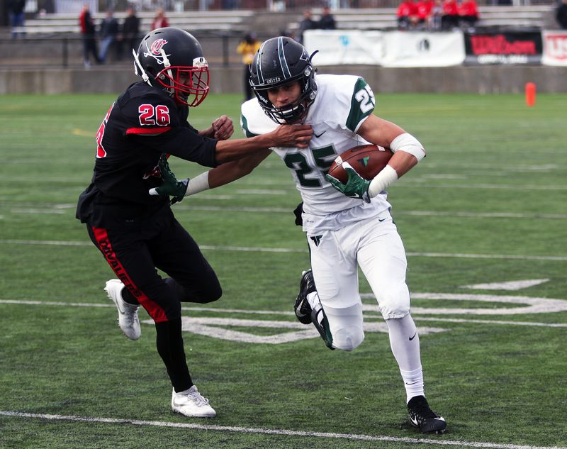 DAN BROOD - Tigard senior Braden Lenzy (right) looks to get past Clackamas senior Russell Gray during Friday's semifinal contest.