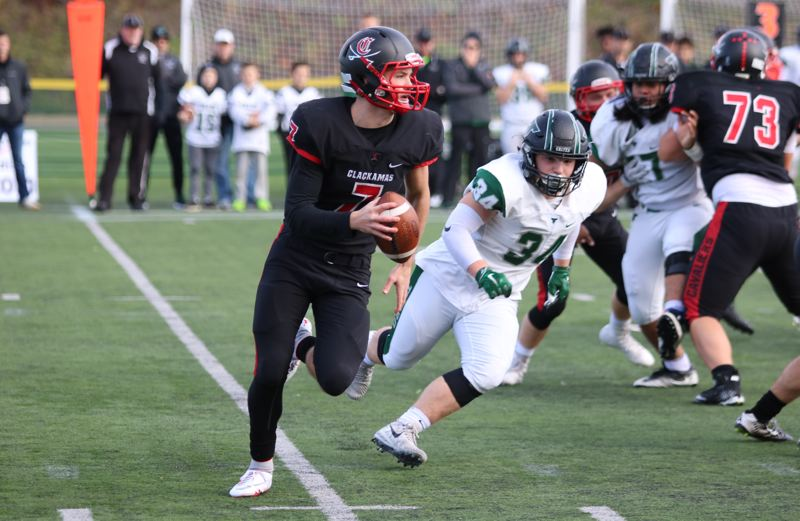 REVIEW/NEWS PHOTO: JIM BESEDA - Clackamas quarterback Mitchell Modjeski threw for 247 yards and three touchdowns as the Cavaliers defeated Tigard 52-7 in Friday's Class 6A football semifinal at Hillsboro Stadium.