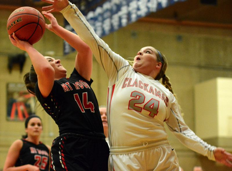 OUTLOOK PHOTO: DAVID BALL - Clackamas CC's Jody Nofziger reaches out to defend Mt. Hood guard Jessica Parker on a drive in the second half. The two were high school teammates at Country Christian.