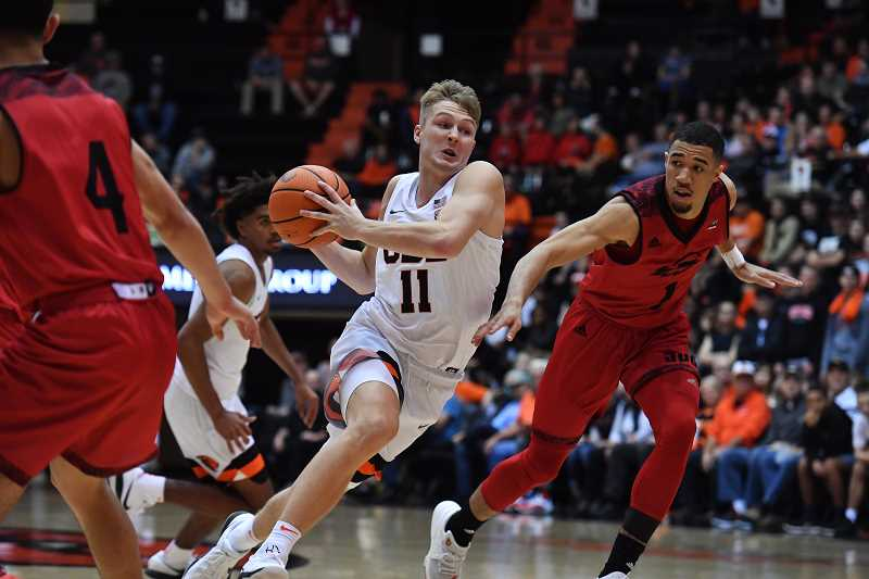 SUBMITTED PHOTO - Wilsonvilles Reichle has gone from being the top player on the team to having to work his way up the ranks on Oregon State Universitys basketball team.