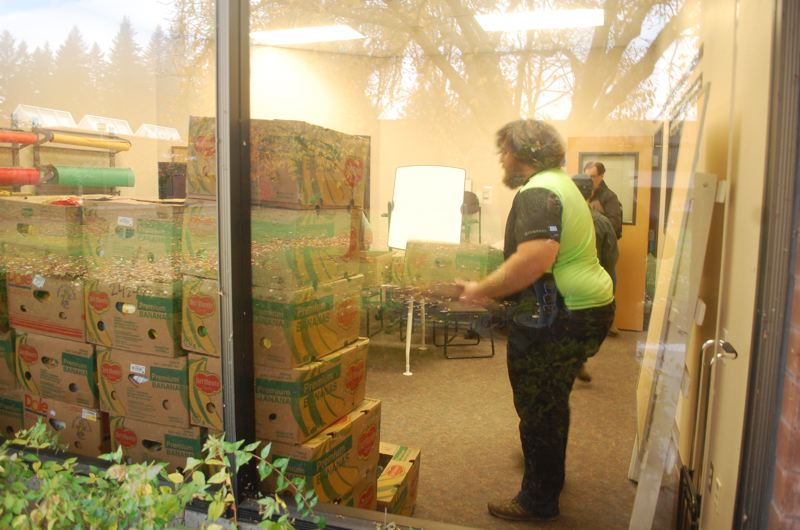 PHOTO BY: RAYMOND RENDLEMAN - More than 2,000 pounds of nonperishable food is unloaded in front of the student-run pantry at Clackamas Community College.