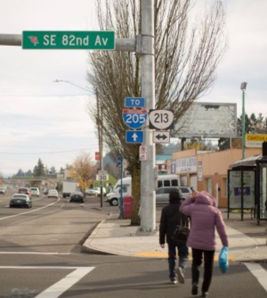 BRYAN M. VANCE/OPB - Pedestrians cross the busy intersection of SE 82nd Avenue and SE Division Street on Sunday, Nov. 19, 2017.