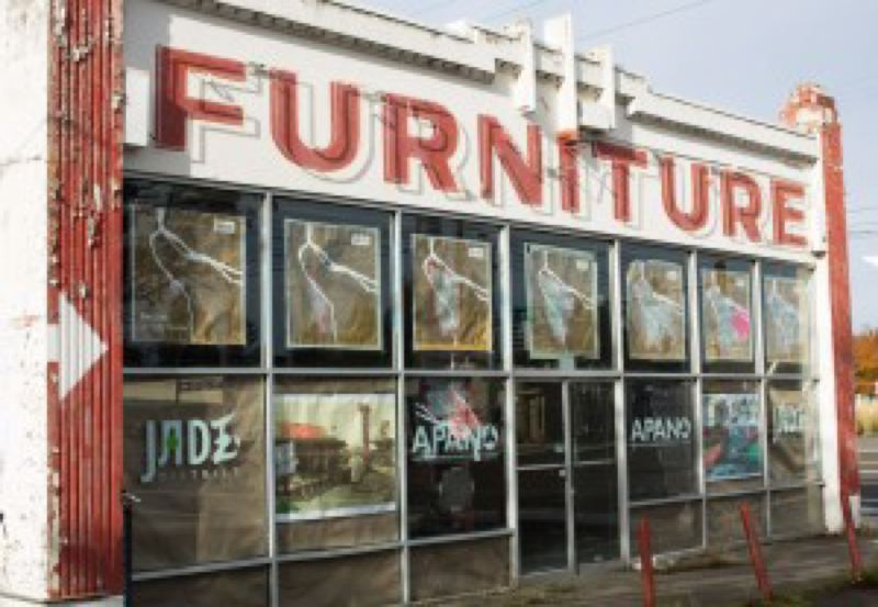 BRYAN M. VANCE/OPB - As part of the effort to remake the neighborhoods along 82nd Avenue, community groups plan to turn this old furniture store into a community center and affordable housing.