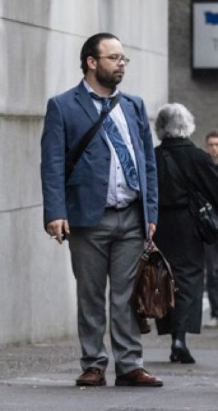 TRIBUNE PHOTO: JONATHAN HOUSE - Portland lawyer Edward Andrew Long, shown outside Multnomah County Courthouse, is fighting a push by legal regulators to suspend him over numerous allegations of misconduct. He denies wrongdoing.