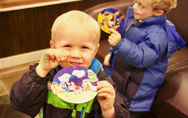 OUTLOOK PHOTO: CHRISTOPHER KEIZUR - Five-year-old Caleb shows off the ornament he made at Frenzi, which was one of the many businesses participating in the Spirit of Christmas.