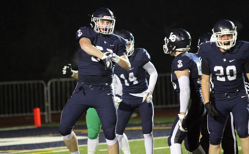 REVIEW PHOTO: MILES VANCE - Lake Oswego senior defensive lineman Shawn Elliott (left) was one of 10 Lakers named to the all-Three Rivers League first team for the 2017 season.