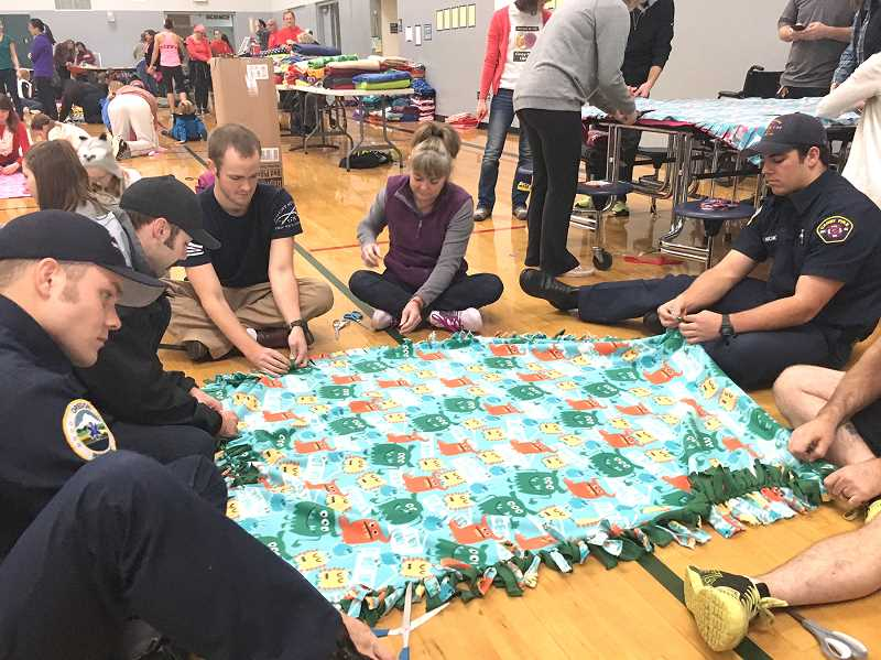 Volunteers will descend on Baker Prairie Middle School Saturday, Dec. 2, at 9 a.m. to create warm blankets for homeless students in the Canby and Molalla areas.