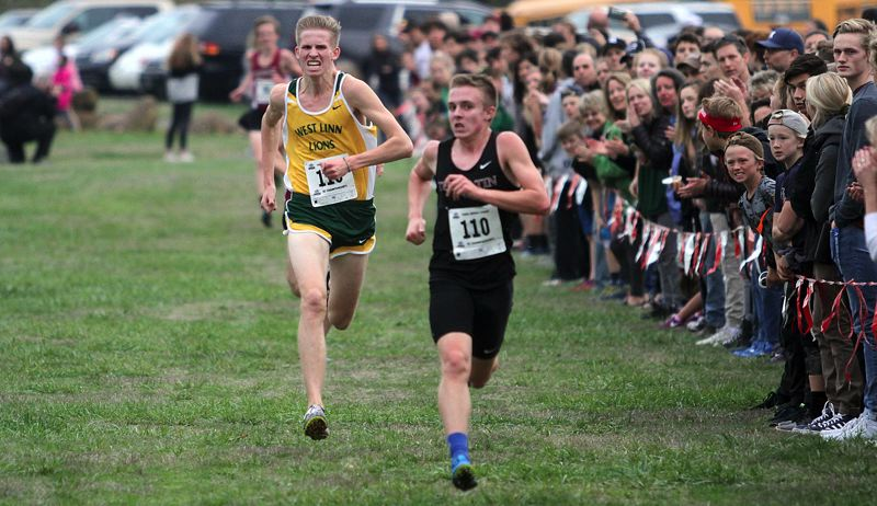 TIDINGS PHOTO: MILES VANCE - West Linn junior John Wetzsteon runs to third at district, and in response, was named to the all-Three Rivers League first team for 2017.