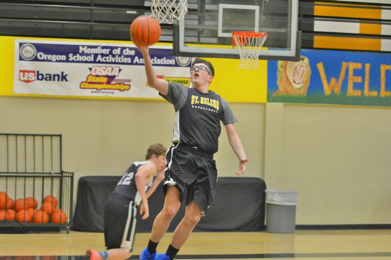 SPOTLIGHT PHOTO: JAKE MCNEAL - Blake Winnier elevates for a layup.